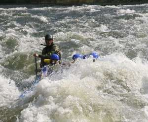 Dusty Rogers Guiding a Raft Through Hell's Hole on the Ocoee River | Raft One