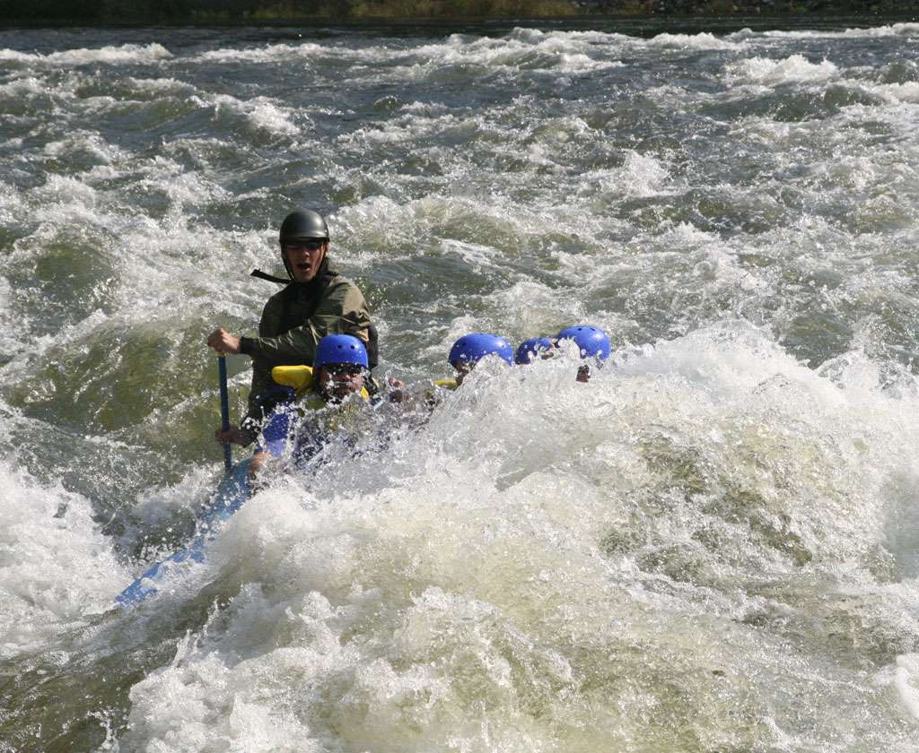 Dusty Rogers guiding raft on Ocoee River